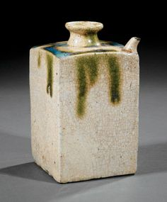 A Japanese Oribe Pottery Sake Flask probably 19th c., rectangular body with flared neck and curved spout, height 7 in
