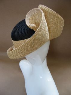 Award winning milliners Ignatius Creegan and Rod Givens, today's Spotlight Artists, hand sew their sturdy straw hats on antique machines and then embellish with wire, ribbons and milliner novelties. For more information on the Oct 6-8, 2016 Smithsonian Craft2Wear Show, visit http://smithsonianassociates.org/craft2wear.