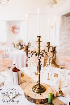 Bronze gold candelabra's, log slice, hessian table runners. Bickley Mill Inn wedding, created by Wild Floral Designs.