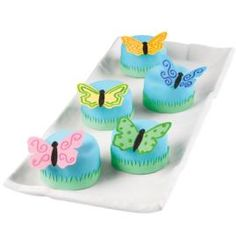 Adorable petits fours topped by colorful butterflies are perfect for so many occasions. Butterfly designs are easily cut using Sugar Sheets! punches and tools.