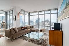 Our property managers offer the ultimate in condo building management services for both townhouse and high-rise apartment style condominiums. Condo Living Room, Living Room Windows, Living Room Decor, Luxury Penthouse, Luxury Condo, Building Management, Property Management, Modern Condo, Modern Living