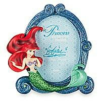 Treasures untold Dive into a dream with your photo immersed in Ariel's sculptured photo frame, all-aglitter with faceted gems and encrusted with sparkling sands fit for a little mermaid princess.