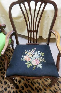 Victorian mahogany carved love seat, faux leopard rug measuring 8'x5'. Stenciled black chair, mahogany chair with needlepoint seat & small needlepoint stool. 2 black pillows. All in very good condition