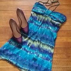 Sale!! Watercolor dress--strapless or halter Stand out in this mid thigh dress in gorgeous watercolors...blues, purples, greens, yellows. More vibrant than pictures show. Stretchy mesh material over turquoise blue lining. Has small halter tie with gold beads. Can be worn as halter or as strapless, since the bust has elastic around top.  Bust is slightly padded. Great for a night out, spring flings, or prom/formal event. Open to all offers and bundles! Ruby Rox Dresses Prom