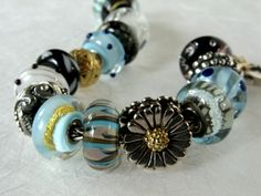 Trollbead bracelet with a lovely blend of warm and cool colours.