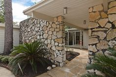 The Stone Age mashes with Mid-Century Modern in Friendswood, where an updated 1961 stunner designed by architect M. Bliss Alexander accents its crisp and clean lines with 12 tons of rock from Wimberly. Listed a week ago with a $1.19 million asking price