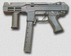 The Italian Spectre sub-machine gun with a top folding stock and specially designed magazine. Military Weapons, Weapons Guns, Guns And Ammo, Rifles, Spectre M4, Battle Rifle, Assault Weapon, Submachine Gun, Home Defense