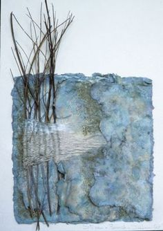 Trees and Water by Inga Hunter.  Layered handmade cotton paper, pastel, paint, sticks twined with silk thread.