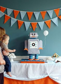 As you my know, my sister has a thing for robots. So when it came time to plan her son's first birthday, she naturally selected a robot theme. The inspiration for the colors (orange and blue) and theme was an. Boy Birthday Parties, 2nd Birthday, Birthday Ideas, Birthday Cakes, Kid Parties, Birthday Board, Themed Parties, Birthday Gifts, Happy Birthday