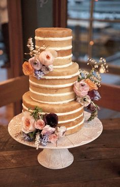 Naked wedding cake with lavender, pink and peach flowers | LoveHer Photography | See more: http://theweddingplaybook.com/chic-rustic-wedding-on-the-foreshore/
