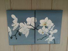 hvid orkide på to lærred