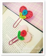 Heart bookmarks made of felt for Valentines Day!  First sew one side of the heart to the paper clip, then sew on embellishments to the other side of the heart and then sew the two sides together.  Easy and can be done by hand. older kids can do it themselves! LOVE THIS! Uses felt, embroidery thread, or beads!