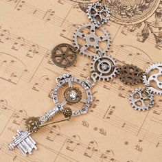 Key and Gears Steampunk Statement Necklace Item Type: Necklaces Fine or Fashion: Fashion Necklace Type: Pendant Necklaces Gender: Unisex Material: Alloy Chain Type: Link Chain Length: 51.5cm Metals Ty