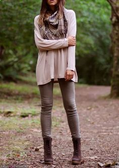 Brown Plaid Scarf, Light Colored Baggy Sweater, Light Gray Leggings, and Brown Boots.