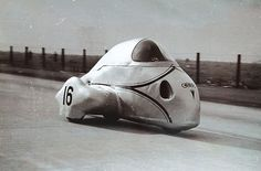 Auto-Union DKW-Kahrman 600cc, streamlined three-wheel record breaker racer (1935). http://www.bing.com/images/search?q=Auto-Union+DKW-Kahrman+600cc&FORM=HDRSC2 http://www.bing.com/images/search?q=popular+science&FORM=HDRSC2