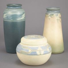 Group of Rookwood Pottery Articles   Comprising two bud vases decorated by Lorinda Epply, circa 1908 and 1913; and a circular box decorated by Sara Sax, in white, pale blue and gray decorated with mistletoe.