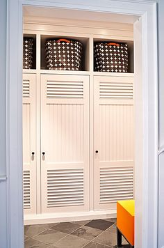 Doors with slats are a good idea, so clothes, shoes, etc can breath and not get musty.