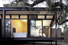 Bathroom, Patio Doors, Compact Contemporary Black Home in Johannesburg, South Africa studio Gass Architecture have recently completed the Westcliff Pavilion. This steel-framed residence is located on the Westcliff Ridge in Johannesburg, South Africa.