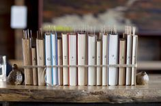 For the name place bookmarks [Note the table cards tucked into the row of vintage books with stamped spines—how creative can you get?]