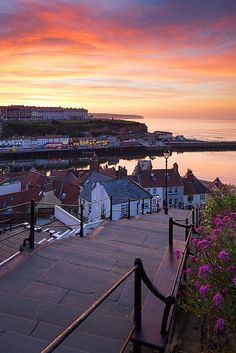 199 Steps to the sea, Whitby, England (by Ally Mac). Whitby, is where Bram Stoker based his book Dracula. The old Abbey is at the top of the steps, along with the YHA. Entertaining in October, when they are the host of a large Goth gathering. Middle aged men trying to be Robert Smith, from The Cure. :-)