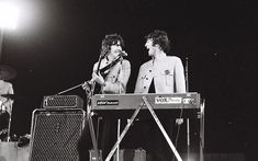 George Harrison and John Lennon laugh during the Shea Stadium concert  Photos of the Beatles' Shea Stadium performance in August 1965 in New York, taken by amateur photographer Marc Weinstein
