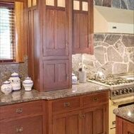 Craftsman kitchen cabinets are defined by simple lines, rugged construction, and very little excess ornamentation. The Craftsman style, an American extension of Britain's Arts and Crafts movement, began in the United States between 1900 and 1930. Recent revivals have reinvigorated the movement, and Craftsman kitchens are growing in popularity today for their historic beauty, craftsmanship, and quality.