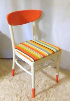 Love this idea. Maybe a different color but definitely try this. Could maybe just do this with a solid wood chair by painting stripes on the seat.