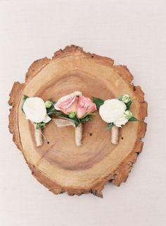 Classic traditional ivory and rose boutonnieres: http://www.stylemepretty.com/california-weddings/san-juan-capistrano/2016/09/23/old-world-elegance-meets-garden-romance/ Photography: Sposto - http://spostophotography.com/