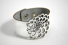 Dhalia flower leather cuff.  Just beautiful to wear and always draws compliments from friends and family!  $30