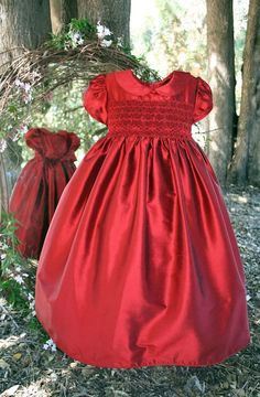 For that special girl, a classic holiday dress that combines true hand smocking and hand embroidery