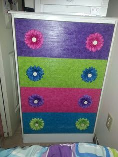 My daughter's dresser redone with modge podge and fabric, then put flowers behind the knobs!!