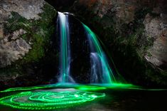 """In """"Neon Luminance,"""" long-exposure photography transforms the scenic waterfalls of Northern California into psychedelic spectacles using a colorful range of high-powered glow sticks."""
