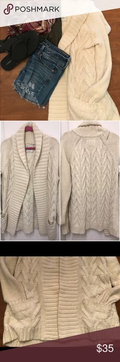 Cable Knit Cardigan EUC A&F cream colored cardigan in size large (but feels like an XL). This is a heavier style cardigan kind of like a light jacket for spring, and very comfy. There is slight pilling throughout, from being washed but does not ruin the sweater at all. I loved this, but it's just too big for me. There's no rips, tears, or stains in almost perfect condition. From a 🐶 friendly home. Abercrombie & Fitch Sweaters Cardigans