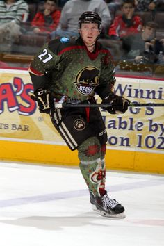 12.22.13 - Hershey Bears player, Ryan Stoa, rockin the Bears Specialty Christmas jersey that was auctioned off post game for Hershey Bears charities.  Photo courtesy of JustSports Photograph