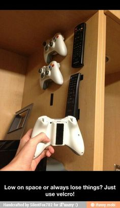 ((Maybe we should do this for the remotes we keep losing! We could even use the remotes while they're stuck on the wall by the couch. Also, there's the option of putting loops on the controllers and hanging them on adhesive hooks.))