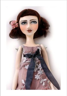 This Polymer clay doll is approx 13.75 from head to toe. She is painted using the finest European acrylics available and sealed with a UV