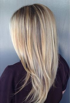 Beautiful and beachy blonde hair is just a salon appointment away when you sit in colorist Katherine Hyde's chair. Perfectly blended and placed highlights are key to get a natural, sun kissed look.