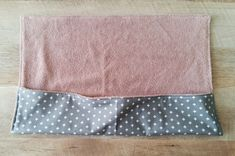 Create a pouch by sewing down each side of the travel wrap