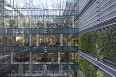 The atrium linking the two buildings features a vertical garden.