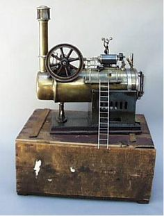 toy steam engine - my brother had one of these - stunk to high heaven and was pretty dangerous.  I stayed clear of it when he had it out, it scared me!