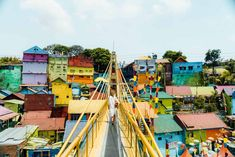Java owns the most colorful rainbow village you have ever seen! Just a few years ago, an entire slum area in Malang, Indonesia was painted. Small Entrance, Colorful Umbrellas, Blue City, Over The River, Slums, Malang, Train Tracks, Java, The Locals
