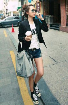 Korean fashion; mixing casual with sport jackets and nice purses...don't forget the ball cap either ;)