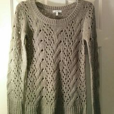 Delia's Sparkly Silver/Gray Knit Sweater Beautiful, barely worn Delia's sweater. Thick knit design, gray sparkly yarn, long sleeve, and incredibly comfortable! Fits a small to a medium! NO trades NO PayPal Delia's Sweaters Crew & Scoop Necks