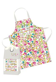 MEET CAROLINE GARDNER The popular London designer known for her playful use of  color and scale, and for her Royal Mail stamp design—a  light-hearted wedding cake.  Look as delicious as the food you prepare. One size fits  all, with adjustable neck strap and waist ties. Two large  front pockets. 100% cotton canvas. Machine wash. Gift box. Shop the  entire Caroline Gardner Colle...