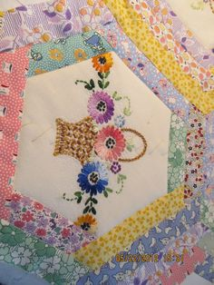 Applique and more: Embroidered quilt topper