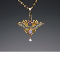 Phillipe Wolfers - Nike Pendant  This 18-carat yellow gold Art Nouveau pendant is called Nike – goddess of victory.The stylized wings are enamelled. Marked on the back of the pendant with the monogram P W in a shield for Phillipe Wolfers. Brussels c. 1901