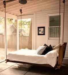 hanging bed. I would love this on a screened in back porch...warm summer nights swaying in the dark, oh my!