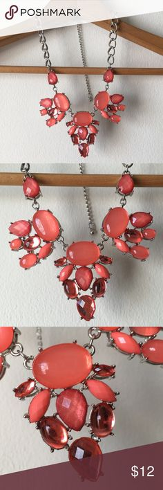 Coral statement necklace Beautiful statement necklace from Charming Charlie, silver tone hardware with coral beads and gems. Adjustable length. Only worn a few times, has been stored in a jewelry. Any signs of wear from storage are minimal (faint scratches) and not noticeable unless you're looking super close.         Reasonable offers welcome.🎀 No lowballing, please.❌ No trades or non-posh transactions!🚫 Bundle & save!💰 Charming Charlie Jewelry Necklaces