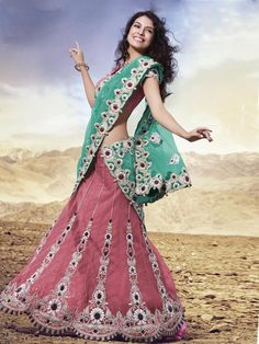 This remarkable pink traditional lehenga saree iscrafted in nett material and is a must have in your ethnic closet. It has an excellent stone work and designer wok all over the patli which gives it a gorgeous look while the pallu of the saree is of contrasting color and is highlighted with stone work all over. (Slight variation in color is possible)