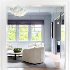 Light Gray Paneled Sitting Room with Brass Fireplace Surround - Transitional - Living Room Bookcase With Glass Doors, Built In Bookcase, White Beadboard, Bedroom With Sitting Area, Striped Chair, Cottage Living Rooms, Living Spaces, White Fireplace, Transitional Living Rooms